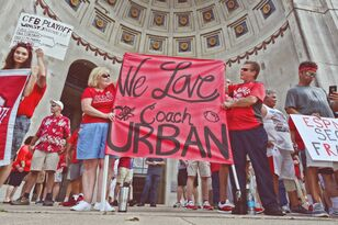Buckeye Fans Come Out by the 100s to Support Head Coach Urban Meyer