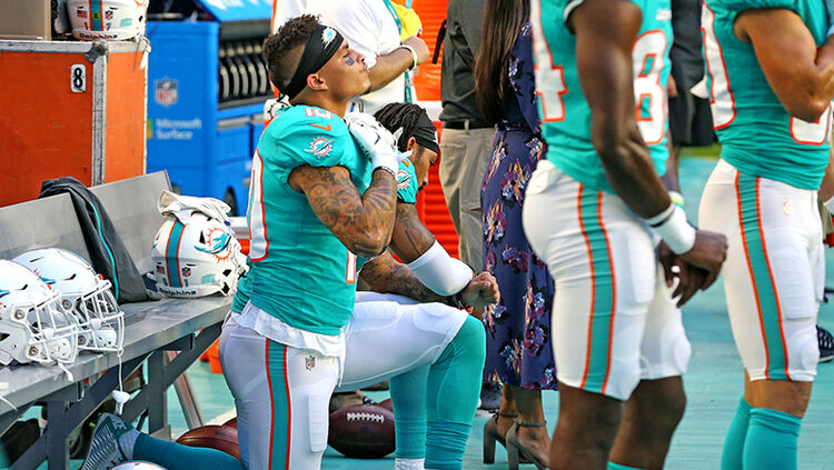 Miami Dolphins receivers Kenny Stills and Albert Wilson kneel during the national anthem