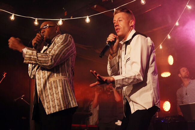 Wanz (L) and Macklemore perform onstage at the iHeartRadio Official SXSW Showcase on March 12, 2013 in Austin, Texas. (Photo by Roger Kisby/Getty Images for iHeartradio)