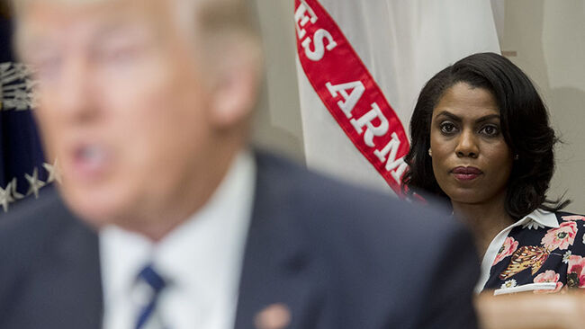 Omarosa Manigault (R), White House Director of Communications for the Office of Public Liaison, sits behind US President Donald Trump