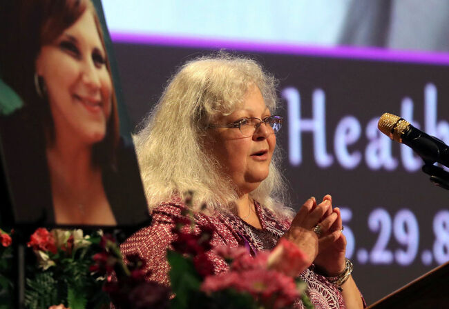 CHARLOTTESVILLE, VA - AUGUST 16: Susan Bro, mother to Heather Heyer, speaks during a memorial for her daughter at the Paramount Theater on August 16, 2017 in Charlottesville, Va. Heyer was killed Saturday, when a car rammed into a crowd of people protesting a white nationalist rally. (Photo by Andrew Shurtleff-Pool/Getty Images)