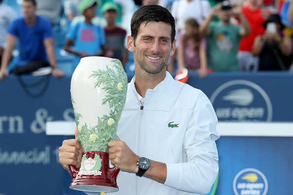 Novak Djokovic hoists the Western and Southern Open trophy