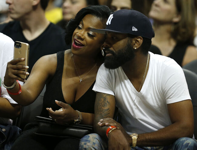 Washington Wizards v Atlanta Hawks - Game Six ATLANTA, GA - APRIL 28: 'Real Housewives of Atlanta' cast member Kandi Burress takes a selfie with her husband, Todd Tucker, during Game Six of the Eastern Conference Quarterfinals between the Atlanta Hawks and the Washington Wizards at Philips Arena on April 28, 2017 in Atlanta, Georgia. NOTE TO USER: User expressly acknowledges and agrees that, by downloading and or using this photograph, User is consenting to the terms and conditions of the Getty Images License Agreement. (Photo by Mike Zarrilli/Getty Images)