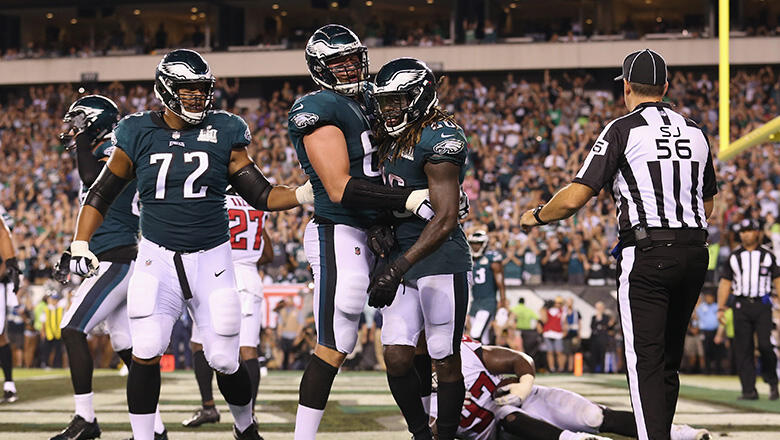 Lane Johnson #65 celebrates a two point conversion by Jay Ajayi #26 of the Philadelphia Eagles during the fourth quarter against the Atlanta Falcons at Lincoln Financial Field on September 6, 2018 in Philadelphia, Pennsylvania.