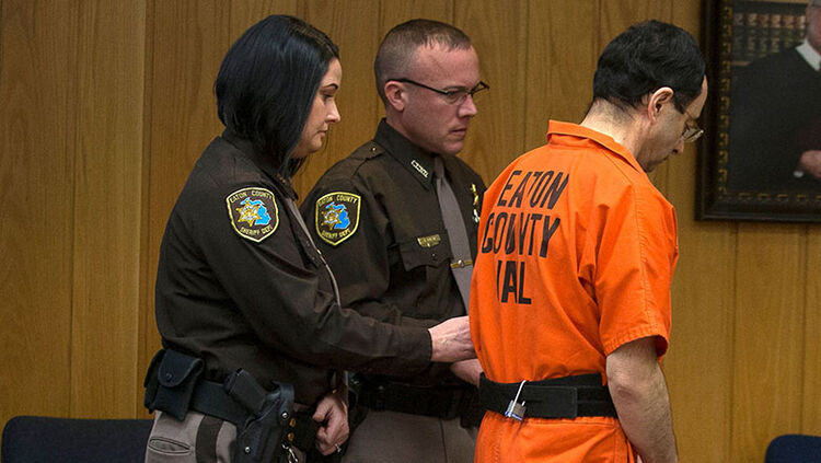 Larry Nassar is led from the courtroom after being sentenced by Judge Janice Cunningham to 40 to 125 years in prison for three counts of criminal sexual assault in Eaton County Circuit Court
