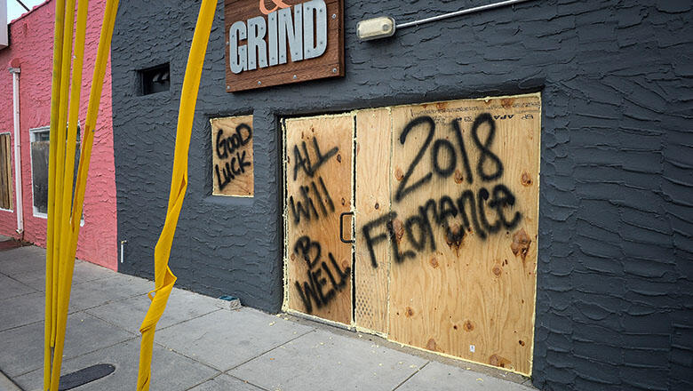 Plywood displaying messages protects window and doors of a property ahead of Hurricane Florence in Carolina Beach, North Carolina