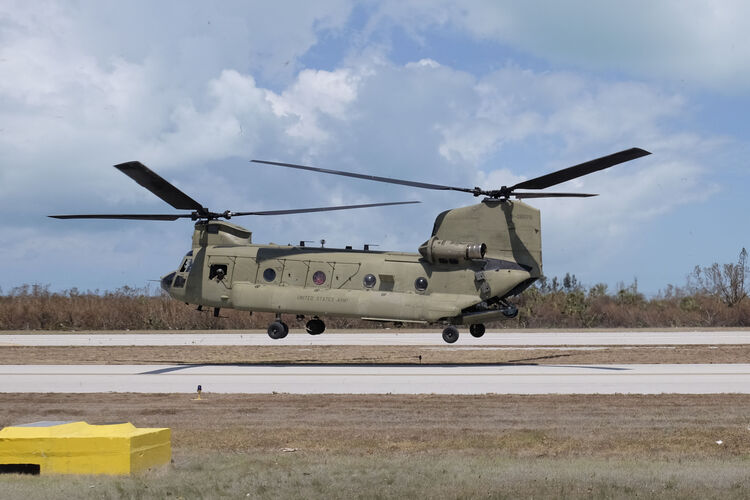 A Chinook helicopter with the Florida Army National Guard lifts fom Marathon Airport on September 13, 2017 in Marathon, Florida. The Federal Emergency Managment Agency has reported that 25-percent of all homes in the Florida Keys were destroyed and 65-percent sustained major damage when they took a direct hit from Hurricane, 2017. The Florida Keys still lacks water, electricity or mobile phone service. Residents are still not permitted to go further south than Mile Marker 73. The Federal Emergency Managment Agency has reported that 25 percent of all homes in the Florida Keys were destroyed and 65 percent sustained major damage when they took a direct hit from Hurricane Irma. GASTON DE CARDENAS/AFP/Getty Images