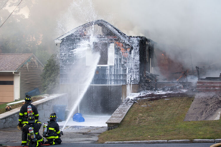 LAWRENCE, MA - SEPTEMBER 13: Firefighters work to extinguish a fire caused by over pressurized gas lines on September 13, 2018 in Lawrence, Massachusetts. Dozens of fires broke out in Lawrence, North Andover and Andover because of the gas lines. (Photo by Scott Eisen/Getty Images)