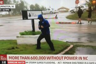 Reporter Battling Hurricane Looks Ridiculous When Dudes Casually Walk By