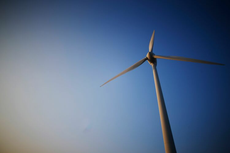 A picture taken on February 22, 2018 shows a wind turbine in Nibas, northern France. (Credit: CHARLY TRIBALLEAU/AFP/Getty Images)