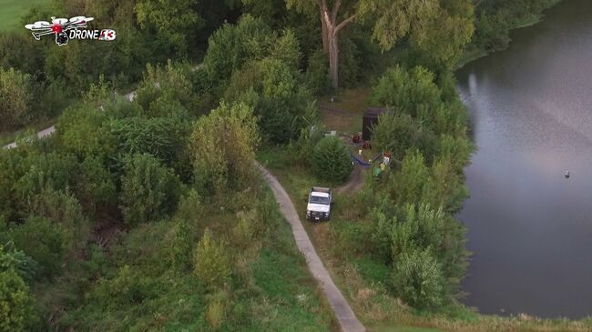 WHO TV Channel 13 Drone shows tent camp set up near golf course in Ames
