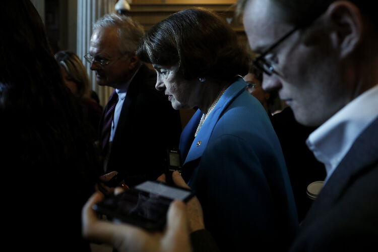 Senate Lawmakers Address The Media After Their Weekly Policy Luncheons WASHINGTON, DC - SEPTEMBER 18: U.S. Sen. Dianne Feinstein (D-CA) speaks with reporters ahead of the weekly policy luncheons on Capitol Hill September 18, 2018 in Washington, DC. Senate Majority Leader Mitch McConnell has announced a hearing before the Judiciary Committee with Supreme Court nominee Brett Kavanaugh and his accuser, Christine Blasey Ford, next Monday. (Photo by Aaron P. Bernstein/Getty Images)