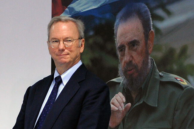 Google Executive Chairman Eric Schmidt poses beside a picture of late Cuban political leader Fidel Castro during the signing of a bilateral agreement with Cuban national telecom provider (ETECSA) in Havana, on Decemberr 12, 2016. / AFP / YAMIL LAGE (Photo credit should read YAMIL LAGE/AFP/Getty Images)