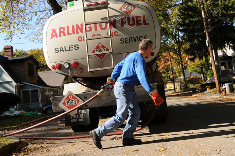 ARLINGTON, MA - OCTOBER 20: Mike Walsh of Arlington Fuel Oil Co., Inc. makes a delivery of home heating oil October 20, 2008 in Arlington, Massachusetts. Home heating oil prices continue to fluctuate in the recent uncertain economy and late last week the government released $5.1 billion in fuel assistance to states to help poor people cope with the high costs of fuel expected this winter. (Photo by Darren McCollester/Getty Images)