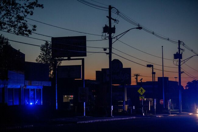 LAWRENCE, MA - SEPTEMBER 13: Police lights illuminate Winthrop St. after the power was cut to the entire city of Lawrence and other surrounding communities becuase of an outbreak of fires caused by over pressurized gas lines on September 13, 2018 in Lawrence, Massachusetts. Dozens of fires broke out in Lawrence, North Andover and Andover because of the gas lines. (Photo by Scott Eisen/Getty Images)