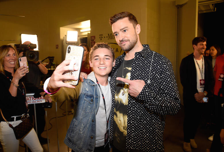 Selfie Kid Ryan McKenna Reunites with Justin Timberlake at the 2018 iHeartRadio Music Festival