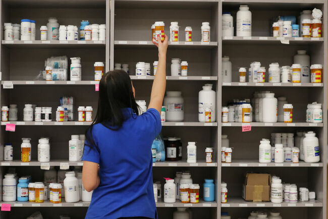 MIDVALE, UT - SEPTEMBER 10: A pharmacy technician grabs a bottle of drugs off a shelve at the central pharmacy of Intermountain Heathcare on September 10, 2018 in Midvale, Utah. IHC along with other hospitals and philanthropies are launching a nonprofit generic drug company called 'Civica Rx' to help reduce cost and shortages of generic drugs. (Photo by George Frey/Getty Images)