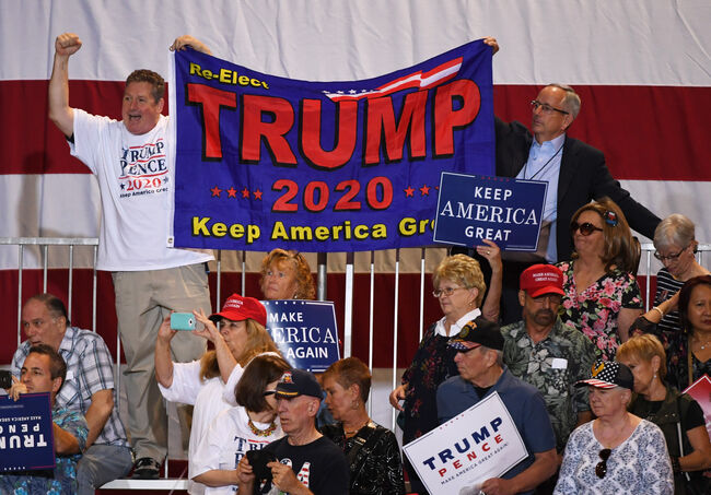 LAS VEGAS, NV - SEPTEMBER 20: Supporters hold up a banner as U.S. President Donald Trump (not pictured) speaks during a campaign rally at the Las Vegas Convention Center on September 20, 2018 in Las Vegas, Nevada. Trump is in town to support the re-election campaign for U.S. Sen. Dean Heller (R-NV) as well as Nevada Attorney General and Republican gubernatorial candidate Adam Laxalt and candidate for Nevada's 3rd House District Danny Tarkanian and 4th House District Cresent Hardy. (Photo by Ethan Miller/Getty Images)