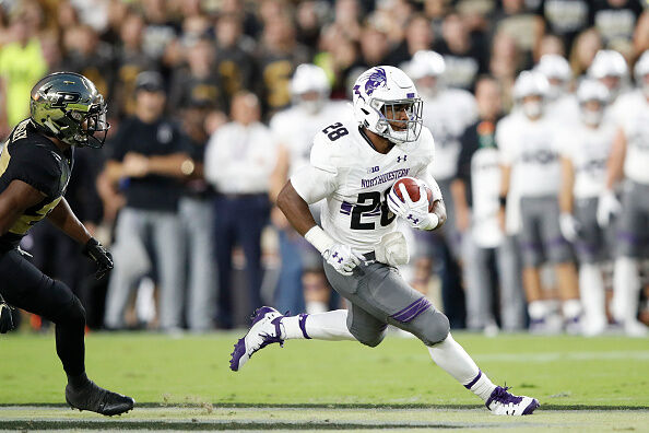 WEST LAFAYETTE, IN - AUGUST 30: Jeremy Larkin #28 of the Northwestern Wildcats runs the ball against the Purdue Boilermakers in the first quarter of a game at Ross-Ade Stadium on August 30, 2018 in West Lafayette, Indiana. (Photo by Joe Robbins/Getty Images)