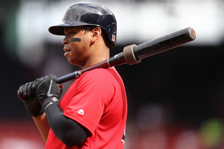 BOSTON, MA - SEPTEMBER 26: Rafael Devers #11 of the Boston Red Sox looks on from the on deck circle during the first inning against the Baltimore Orioles at Fenway Park on September 26, 2018 in Boston, Massachusetts. (Photo by Maddie Meyer/Getty Images)