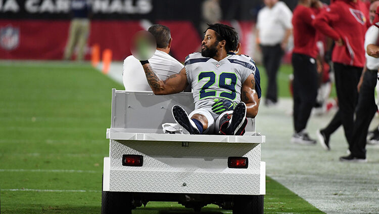 Defensive back Earl Thomas #29 of the Seattle Seahawks gestures as he leaves the field on a cart after being injured during the fourth quarter against the Arizona Cardinals