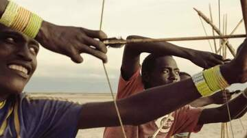 Mike McConnell - Tanzanian Tribe: one of the last hunter-gathers...with a Reds shirt!