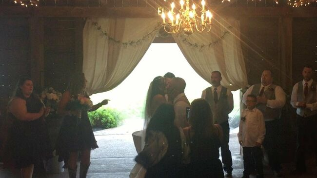 Wedding Photographer Shoves Bride's Step-Mom To Get A Picture