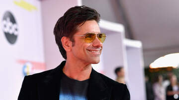 iHeartRadio Spotlight - John Stamos Wore A Jonas Brothers T-Shirt To the AMAs & Twitter Lost It