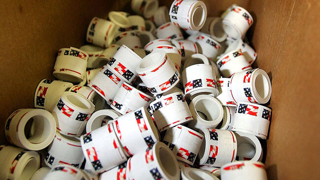 Newly printed rolls of stamps await packaging at the United States Treasury Bureau of Engraving and Printing facility