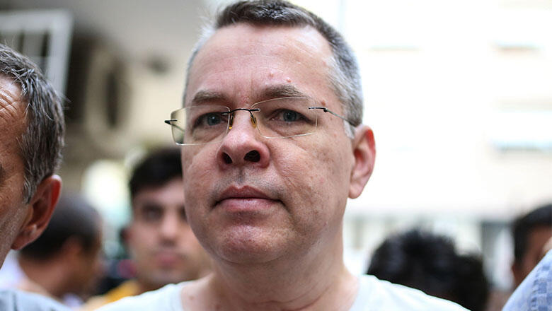 US pastor Andrew Craig Brunson escorted by Turkish plain clothes police officers arrives at his house