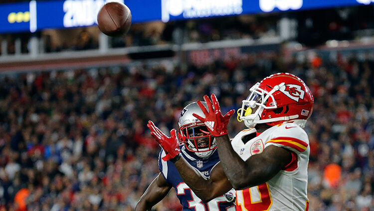 Tyreek Hill #10 of the Kansas City Chiefs catches a touchdown pass against the defense of Devin McCourty #32 of the New England Patriots