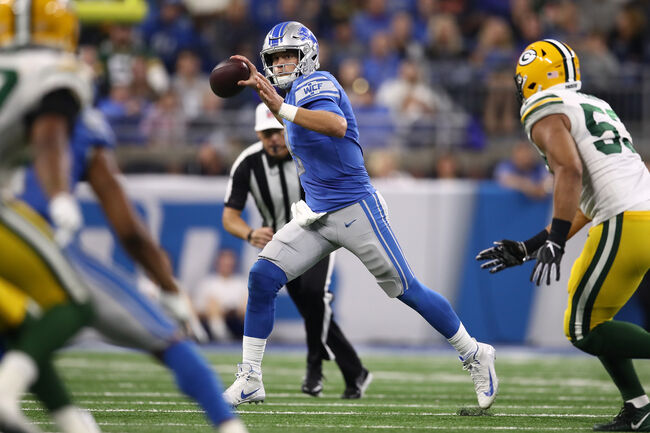 Images Courtesy of Getty Images - Matthew Stafford leading the offense against the Packers