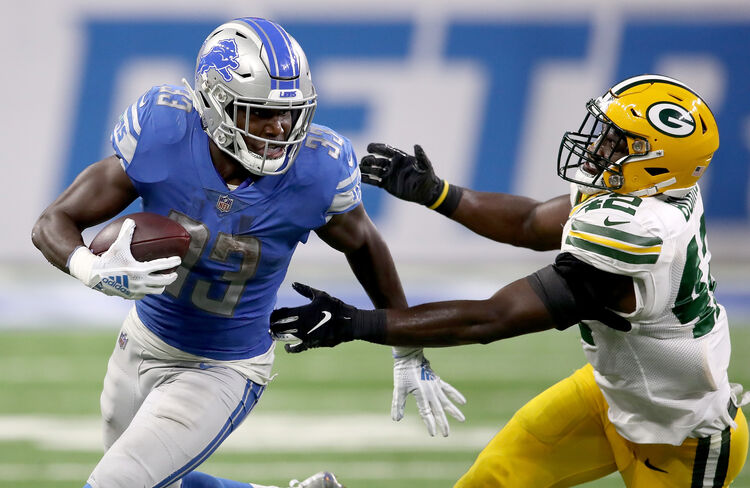 Images Courtesy of Getty Images - Kerryon Johnson breaks a tackle and heads down field
