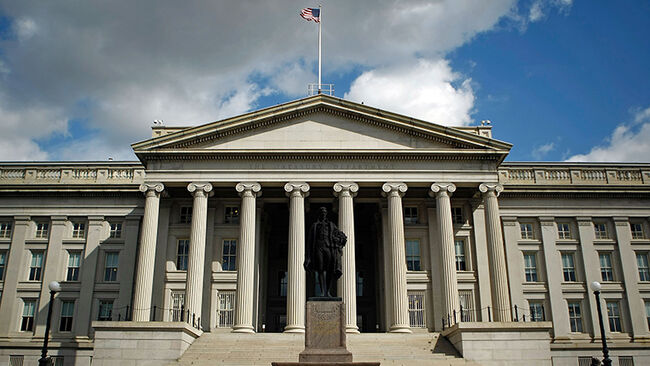 A statue of the first United States Secretary of the Treasury Alexander Hamilton stands in front of the U.S. Treasury