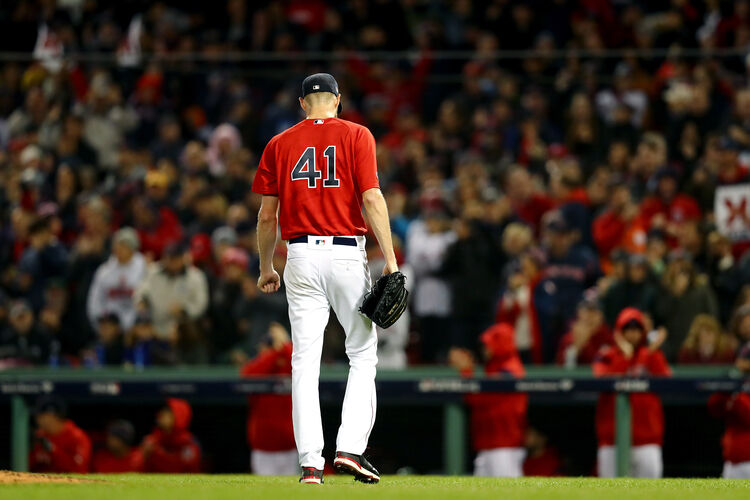 BOSTON, MA - OCTOBER 13: Chris Sale #41 of the Boston Red Sox walks off the field after the top of the fourth inning against the Houston Astros in Game One of the American League Championship Series at Fenway Park on October 13, 2018 in Boston, Massachusetts. (Photo by Tim Bradbury/Getty Images)