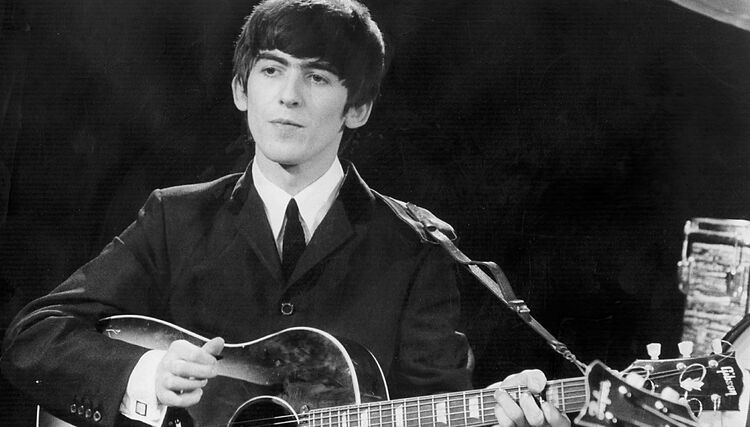 "Hear The Beatles' Acoustic Version of ""While My Guitar Gently Weeps"""
