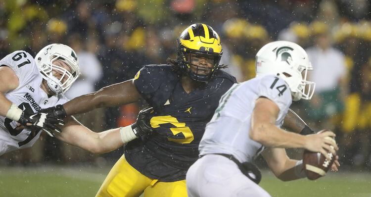 Getty Images - Michigan's Rashan Gary stalks Michigan State's Brian Lewerke