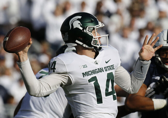 Getty Images - Brian Lewerke back to pass for MSU