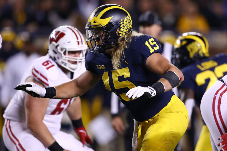 Getty Images - Michigan's Chase Winovich putting pressure on Wisconsin's backfield