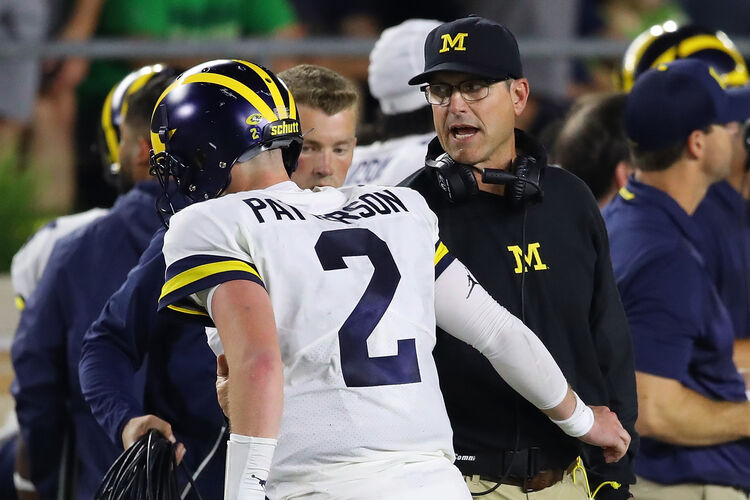 Getty Images - Jim Harbaugh talks to Shea Patterson