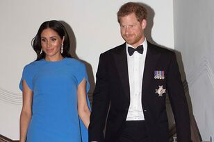 Meghan Markle Shows Off Baby Bump In Stunning Evening Gown