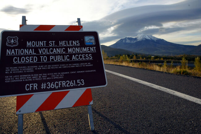 MOUNT ST. HELENS, WA - OCTOBER 12: A sign alerts visitors to a road closure on SR504 leading up to Mount St. Helens on October 12, 2004 at Mount St. Helens National Monument, Washington. Seismic activity slowed last week prompting a downgrade from level three, indicating an eruption or imminent danger of one, to level two warning that an eruption is likely though not imminent. (Photo by Craig Mitchelldyer/Getty Images)
