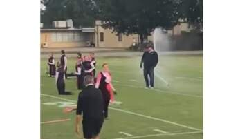 Mountain Man Jay - Band Director Protects His Band from Sprinkler