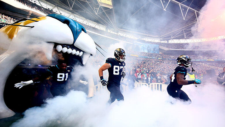 The Jacksonville Jaguars run onto the pitch during the NFL International Series game between Philadelphia Eagles and Jacksonville Jaguars at Wembley Stadium