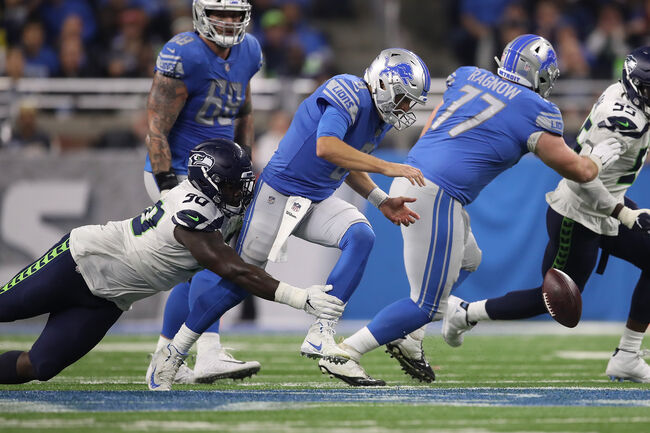 Getty Images - Matt Stafford gets hit and fumbles the ball against the Seahawks.
