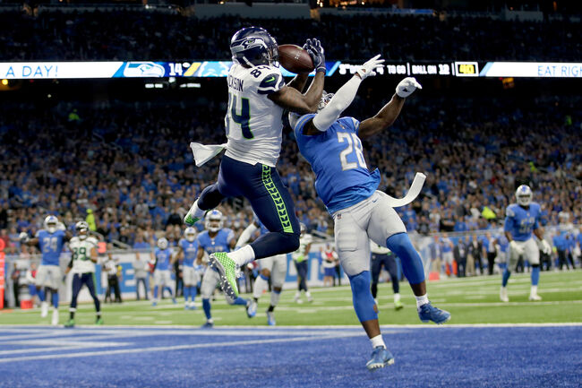 Getty Images - Ed Dickson goes up and over Quandre Diggs for a touchdown.