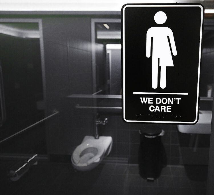 DURHAM, NC - MAY 10: Gender neutral signs are posted in the 21C Museum Hotel public restrooms on May 10, 2016 in Durham, North Carolina. Debate over transgender bathroom access spreads nationwide as the U.S. Department of Justice countersues North Carolina Governor Pat McCrory from enforcing the provisions of House Bill 2 that dictate what bathrooms transgender individuals can use. (Photo by Sara D. Davis/Getty Images)
