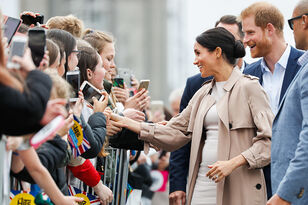 Meghan Markle Was Greeted By Fans Playing The 'Suits' Theme Song