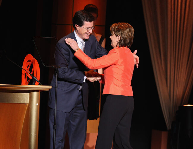 NEW YORK - NOVEMBER 05: Presenter/TV Personality Stephen Colbert and honoree/Speaker of The House Nancy Pelosi on stage during the 2007 'Glamour Women of The Year' award ceremony at Lincoln Center on November 5, 2007 in New York City. (Photo by Stephen Lovekin/Getty Images)