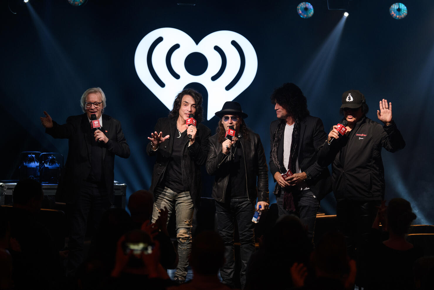 iHeartRadio's Jim Kerr with Paul Stanley, Eric Singer, Tommy Thayer and Gene Simmons. (Photo credit: Chris Owyoung for iHeartRadio)